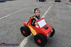 Jennifer: Picture taken 10/31/2014 - All three of our costumes are made out of cardboard boxes. The traffic light has working lights and the monster truck has working headlights, tail lights,...