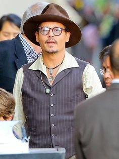 "After announcing his split from Vanessa Paradis, Johnny Depp, in rounded square specs, put on a happy face to promote ""The Lone Ranger"" in Cali!"