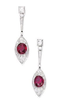 PAIR OF PLATINUM, RUBY AND DIAMOND EARRINGS The navette-shaped pendants centered by two oval-shaped rubies weighing approximately 6.50 carats, framed and suspended by variously-cut diamonds weighing approximately 4.75 carats.
