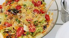 Ready in only 30 minutes, our taco salad is made with taco-seasoned ground beef, lettuce, tomatoes, olives, cheddar cheese and tortilla chips.
