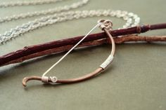 Archery bow necklace - Elven fantasy hunting weapon in antiqued brass and sterling silver - unisex. $27.00, via Etsy.