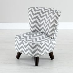 Our Little Slipper Chair is a handmade, miniature version of the popular style, meaning you get the low to the ground, contoured, ultra-soft qualities of the original, in a size fit for kids.  Its soft, custom fabric and solid pine frame make it comfortable and sturdy enough to last many strokes of midnight.