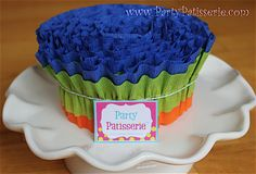 This would be great to stick Cake Pops in!  (Ruffled Crepe Paper)