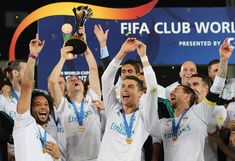 Cristiano Ronaldo Photos - (Front L-R) Real Madrid's Marcelo, Luka Modric, Cristiano Ronaldo and Sergio Ramos celebrate with the FIFA Club World Cup trophy following their victory in the final football match against Gremio FBPA at the Zayed Sports City Stadium in Abu Dhabi on December 16, 2017..Real Madrid defeated Gremio 1-0 to lift the FIFA Club World Cup for the third time in their history. / AFP PHOTO / KARIM SAHIB - Gremio v Real Madrid: Final - FIFA Club World Cup UAE 2017...