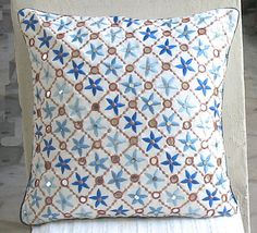off white pillow with sequin mirror work and floral embroidery in blue