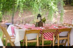 An outdoor Southern Picnic wedding with gingham tablecloths, wildflowers and rustic details. Blue Lantern Farm in Atlanta, Georgia. Photos by www.vervestudio.com