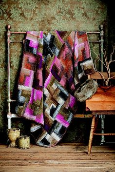 Would love to have a wool blanket like this. Made with Noro yarn.