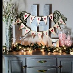 Like the use of the bunting and lights for Christmas decor. Simple & clean.