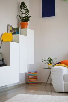 Inspiring Snow White Apartment Design For Spacious And Playful Touch:  Charming Living Room Details At Apartment In Budapest With Floating Wh.