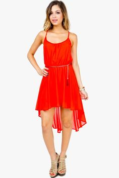 An ethereal and flowy cami dress that is great for your summer outings! Hi-low silhouette. Elastic waist. Chain belt included.