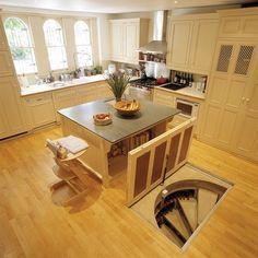 Trap door staircase in kitchen floor