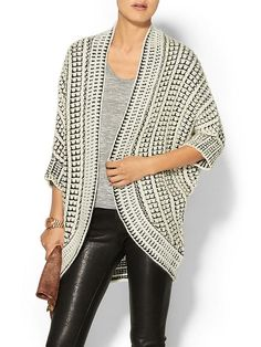 Bundle up in this dramatic cardigan that looks creative but cozy too.