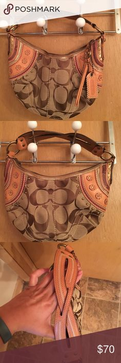 Coach hobo purse Only used a few times, great pre owned condition. Couple of small marks on back - see pictures, but barely noticeable. Accent on corners is gold and cranberry. AUTHENTIC! Coach Bags Hobos