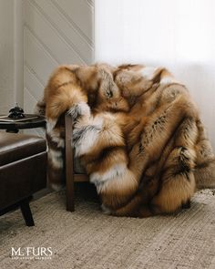 A luxurious fox fur throw is versatile enough to soften any style! Whether you have modern furniture or you adore the classics, it will fit in any room perfectly ✨ Shop our home decor collection now! Faux Fur Blanket, Faux Fur Throw, Fur Bed Throw, Red Bedspread, Fur Decor, Fur Bedding, Fox Fur Coat, Fur Coats, Home Decor Furniture