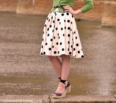 Too cute! Polka-dot skirt and green belted cardigan.
