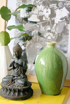 buddha and green vase