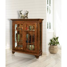 Darby Home Co Shelia Lighted Console Curio Cabinet & Reviews | Wayfair Glass Cabinet Doors, Sliding Glass Door, Cabinet Colors, Adjustable Shelving, Storage Spaces, Console, Solid Wood, Family Room