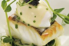 Fillet of cod with poached hen's egg, crushed Jersey Royals and chive butter sauce