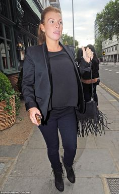 Calm before the storm: Coleen Rooney was seen heading to lunch at Chelsea's The Ivy on Tue...