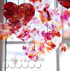 Make crayon hearts for faux stained glass Valentine's Day decor via House of Joyful Noise, featured @savedbyloves