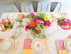 colorful bridal shower ideas // pink, yellow, orange, vintage dishes, calligraphy menu, flowers, gold silverware, metal chairs