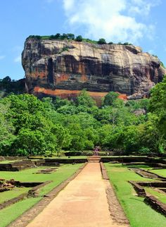 Sigiriya is an ancient rock fortress located in the central Matale District near the town of Dambulla in the Central Province, Sri Lanka. The name refers to a site of historical and archaeological significance that is dominated by a massive column of rock nearly 200 metres (660 ft) high.Sigiriya today is a UNESCO listed World Heritage Site.Check the link to read more http://travelme-srilanka.blogspot.com/search/label/Sigiriya