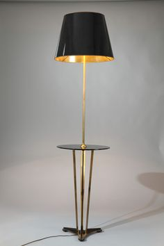 French mid-20th century Neo-classic brass floor lamp in brass and metal with black opaline glass guéridon, on a tripod base.