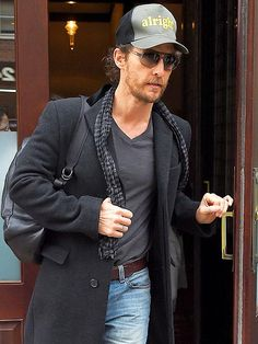 PEOPLE cover boy Matthew McConaughey hangs his catchphrase on his head as he leaves a New York hotel on Wednesday.