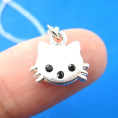 An animal themed necklace featuring a super adorable kitty cat charm with rhinestone eyes! More kitty cat animal jewelry available in our store! Shop Now!