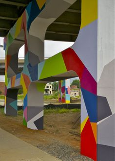 ColorHaus: Primary Flight, a Miami-based street art collective, was chosen to design and paint colorful murals on each of seven large-scale concrete support structures at the Spring Garden Street underpass.