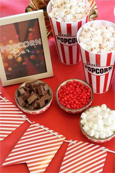 A popcorn bar is a great way for guests to dress up their dish. Offer a variety of toppings so people can add as much or as little of the goodies throughout the party. #toppings #popcorn #Chocolates #marshmallows #redhots