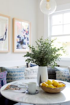 Colorful breakfast nook: http://www.stylemepretty.com/living/2016/09/21/crafting-a-dream-bungalow-in-venice-beach/ Photography: Amy Bartlam - http://www.amybartlam.com/