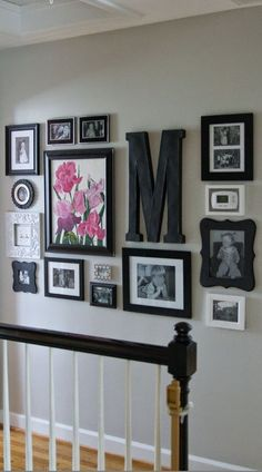 "Check out this hallway gallery wall. Cute! ""M"" for Meilak perhaps?!                                                                                                                                                     More"