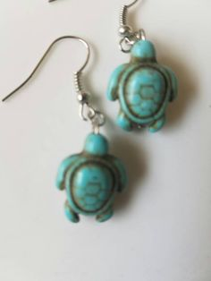 A personal favorite from my Etsy shop https://www.etsy.com/listing/280286768/handmade-turquoise-turtle-silver-toned