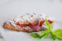 Easy to make Almond Croissants Stuffed With Nutella and Strawberries. Perfect for Mothers Day!