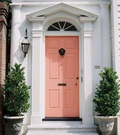 Front Door Paint Colors - Want a quick makeover? Paint your front door a different color. Here a pretty front door color ideas to improve your home's curb appeal and add more style! Coral Front Doors, Coral Door, Front Door Colors, Yellow Doors, Exterior Design, Interior And Exterior, Interior Doors, Painted Doors, Door Knockers