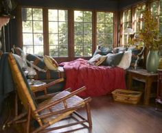 What a great place for a nap! Add a comfy bed to your porch and snuggle in for a fresh-air nap! | 12 cozy porches decked out for fall | Living the Country Life | http://www.livingthecountrylife.com/homes-acreages/country-homes/12-cozy-porches-decked-out-fall/