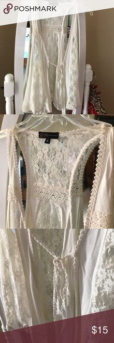 Lace sleeveless cardigan. Cute cardigan. Tie front. Brand new without tags. Tops