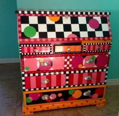 """Painted Lady"" drop-top desk from the front in circles, checks, and stripes 