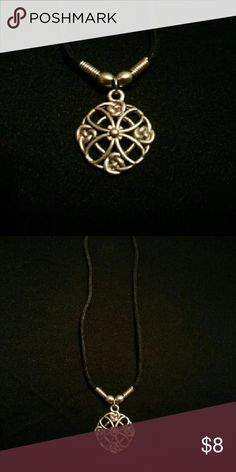 e9bfc51f030 Short Celtic Necklace Rather short black string chain. Pendant is somewhere  in between the size of a nickel and quarter. Pairs really nicely with  chokers!