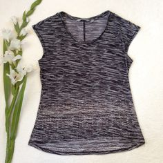 """ATHLETA Tinsley Burnout Tee Sheer burnout Tinsley Tee from Athleta. Super soft & stretchy, lightweight (perfect for travel) and breathable. Scoop neck, cap sleeves, sheer burnout with print on bottom. Shirring at center back seam, semi fitted, hi-low hem. Approx flat meas: length back 23"""", front 21"""", bust 16"""", waist 15"""", hem 18.5"""". 51% polyester 39% cotton machine wash. EUC but has some pilling from wear Athleta Tops"""