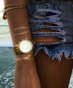 Not leaving the house this summer without metallic tattoos #tribetats