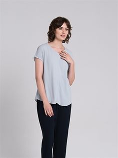 <div>- A shaped style with a V-neck and cap sleeves</div>  <div>- Centre front seam with top stitch detail to break up the front </div>  <div>- Soft drapey viscose with slight texture</div>  <div>- Slightly curved hemline looks great with drapey pants as a dressy option.</div>  <div></div>  <div>Composition: 100% Viscose.</div>  <div>Care: Cool gentle hand wash.</div>  <div></div>  <div>Made in Australia.</div>  <div></div>  <di #TheArkClothingComp...