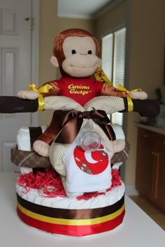 Curious George tricycle of diapers