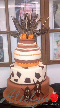 "The end result, its a traditional 3 layer chocolate cake, one of Papadi""s favourites to make. Another happy Soweto customer. #traditionalweddingcakes"