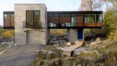 Strait envisioned a house that was molded into its surroundings and that disrupted the landscape as little as possible. Similar to her work, the structure delicately touches down in an organic way. Architecture Details, Modern Architecture, Secret Hiding Places, Container House Design, Container Homes, Glass House, Residential Architecture, Old Buildings, Modern House Design