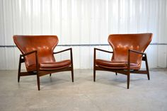Ib Kofod-Larsen Pair of Danish Modern Leather Lounge Chairs | From a unique collection of antique and modern wingback chairs at http://www.1stdibs.com/furniture/seating/wingback-chairs/