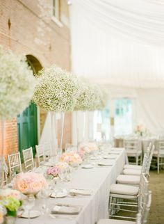 I love the idea of just having tons of baby's breath as the centerpiece flower. And super inexpensive and it's simple.