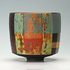 This is a thrown and turned black porcelain bowl by Tony Laverick
