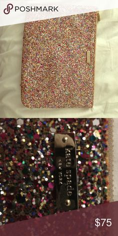 Kate spade clutch Kate spade Glitterball clutch. Zipper closure with patent leather pull, multicolored glitter exterior canvas with gold hardware and hot pink lining. kate spade Bags Clutches & Wristlets